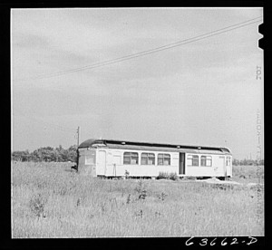 """Old railroad car typical of much improvised housing on outskirts of Detroit, Michigan, August 1941."" Photography by John Vachon. Library of Congress, LC-USF34-063662-D (b&w film neg.)."