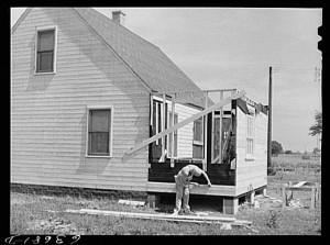 """Defense worker who is on the night shift spends his day working on a new home he is building on outskirts of Detroit, Michigan, August 1941."" Photograph by John Vachon. Library of Congress, LC-USF34-063681-D (b&w film neg.)."