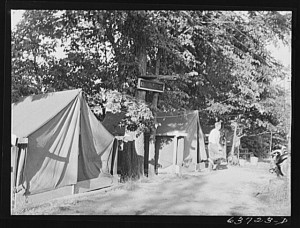 """Tents which rent for five dollars a week to defense workers at Edgewater Park near the Ford bomber plant at Ypsilanti, Michigan, August 1941."" Photograph by John Vachon. Library of Congress, LC-USF34-063723-D (b&w film neg.)"