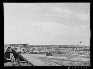 """Ford bomber plant under construction near Ypsilanti, Michigan, August 1941."" Photography by John Vachon. Library of Congress, LC-USF34-063725-D (b&w film neg.)."